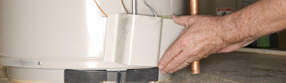 Man repairing a boiler